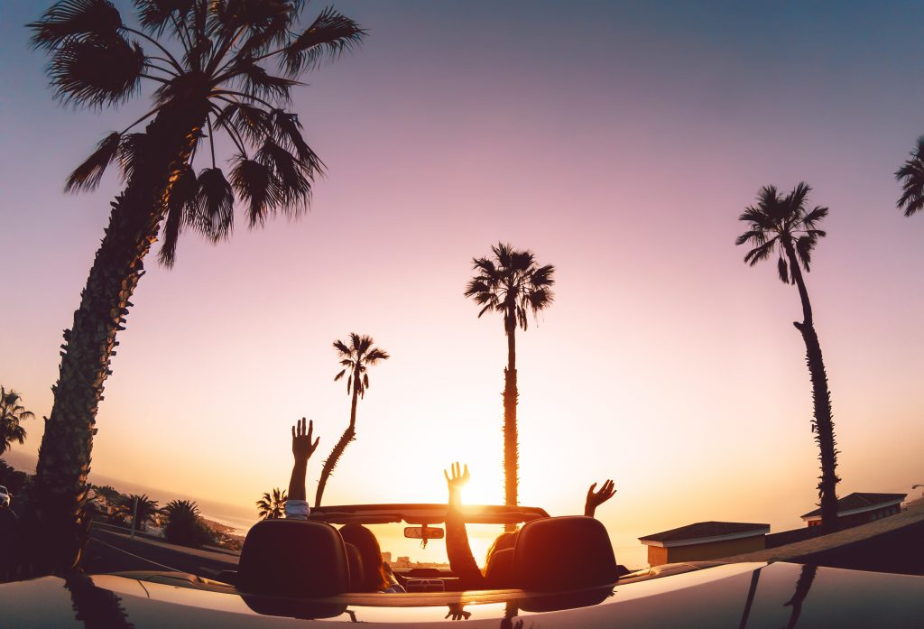 Couple driving a car on holiday because they are taking a payment