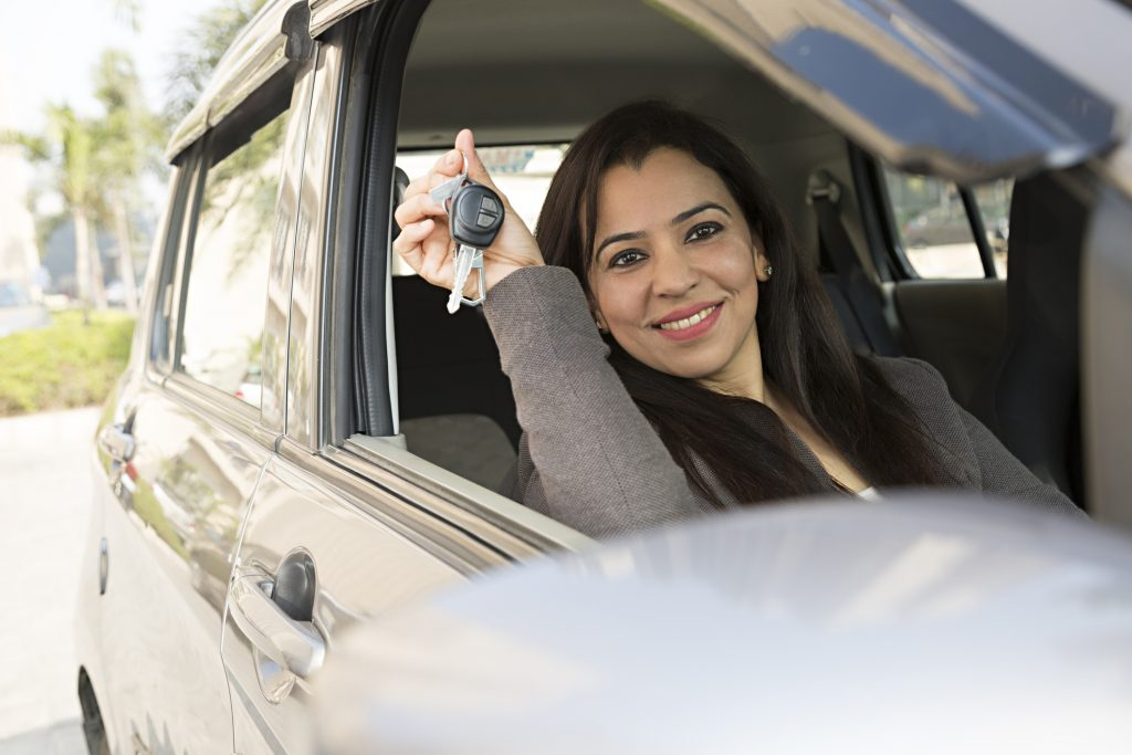 Woman happy after buying a new car
