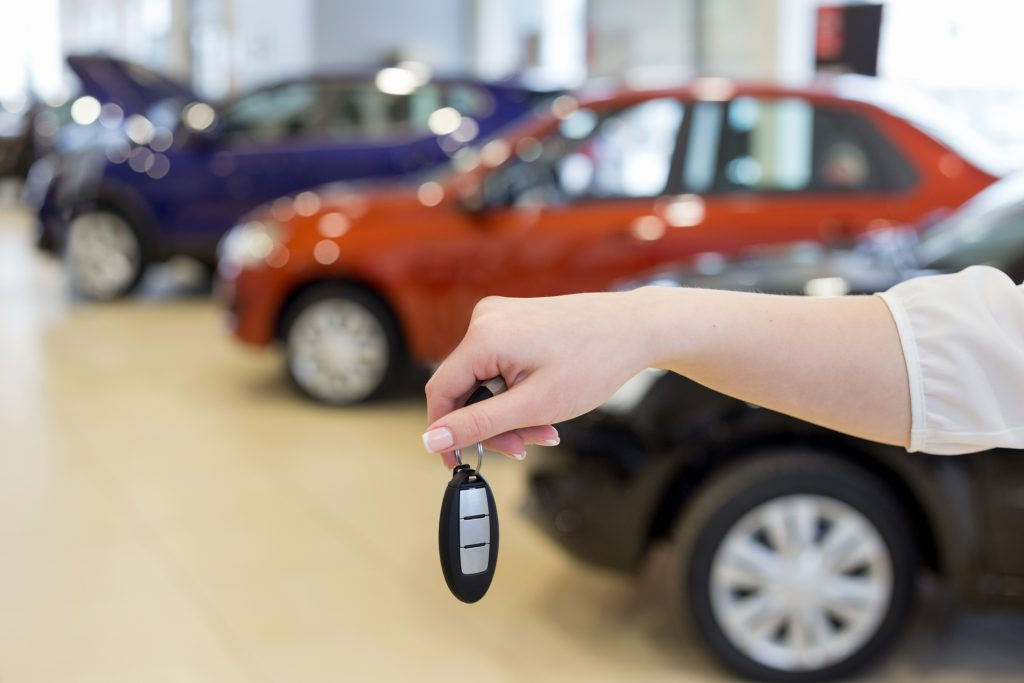 Woman handing over the keys to her car