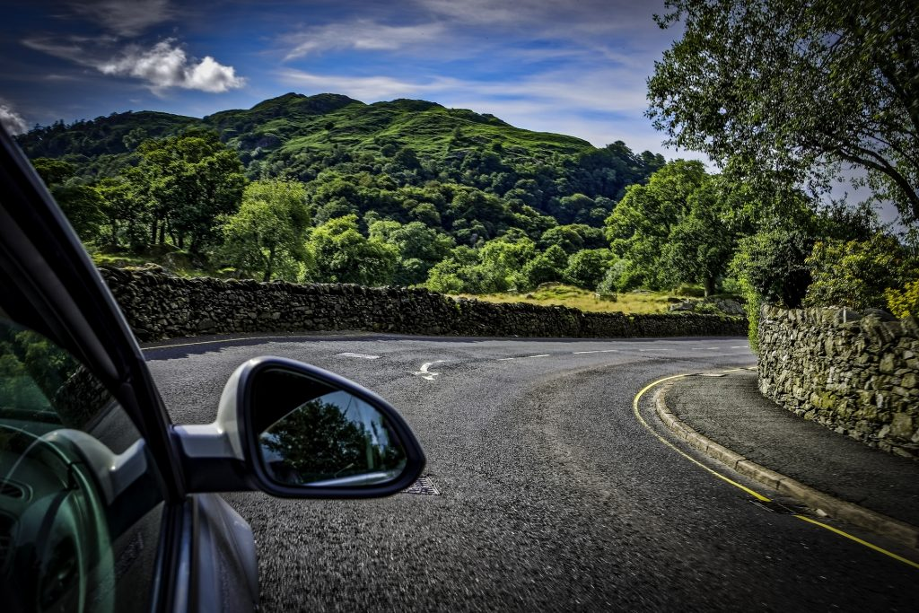 Driving through a country road in the lake district in England, UK
