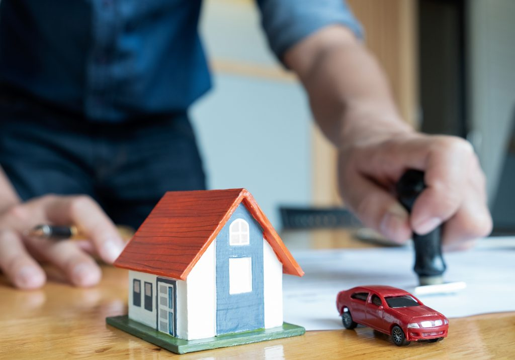 Rubber stamp for home and car purchase approval.