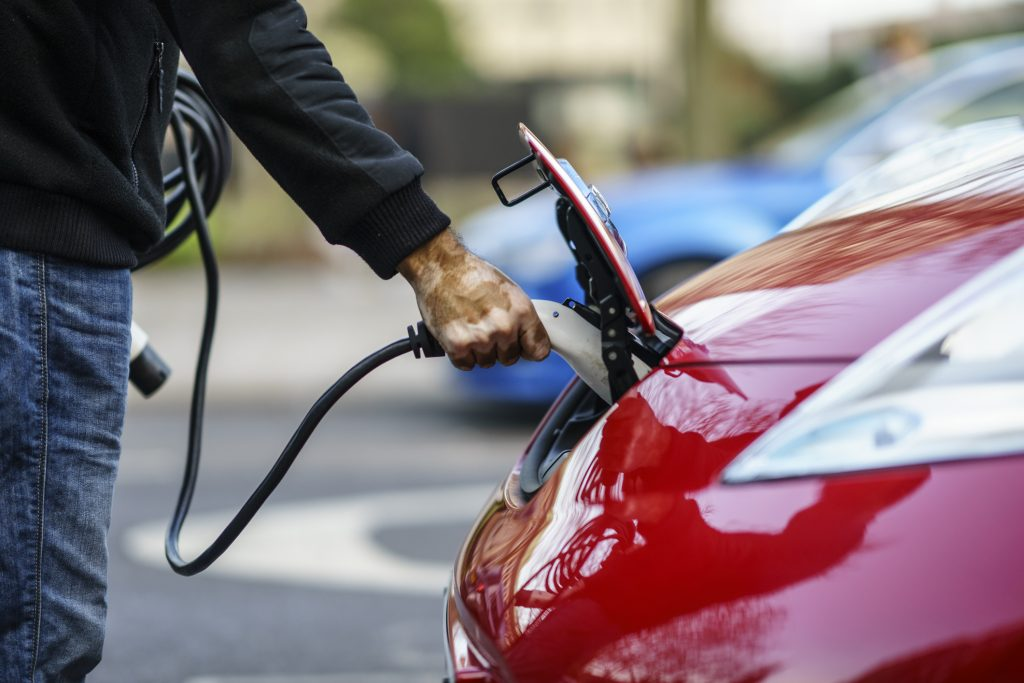 Owner of Nissan Leaf electric car plugged the charger of the car in City Centre of Coventry