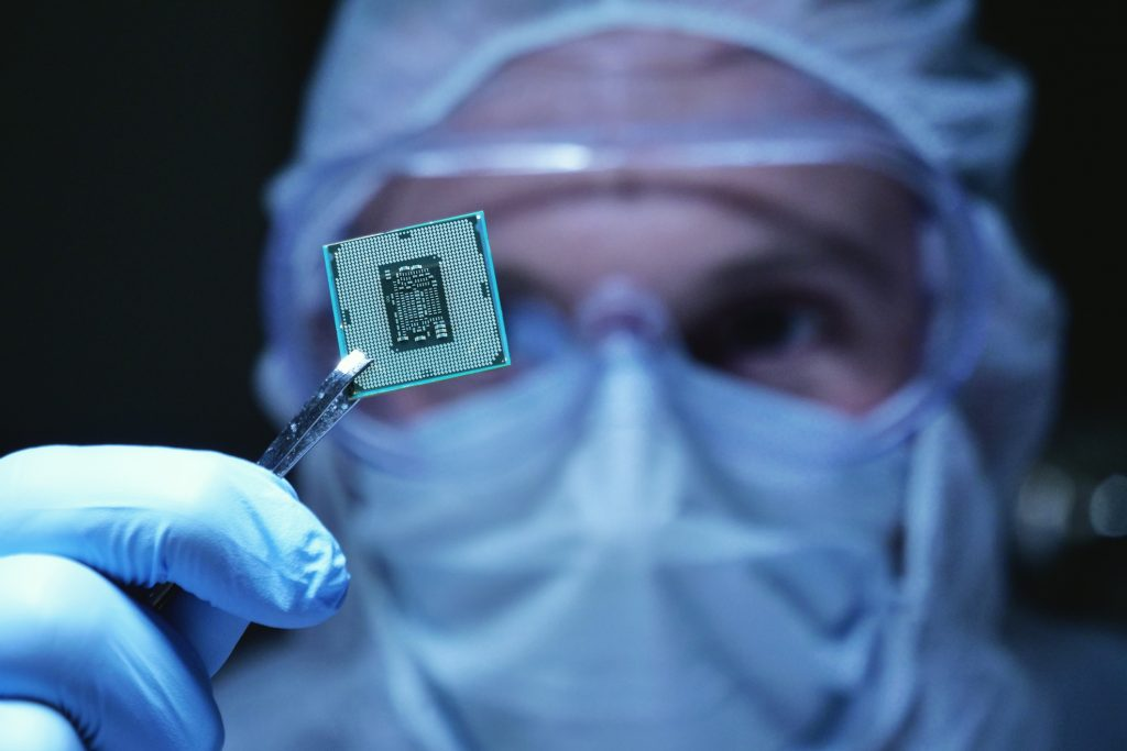 man holding a car semiconductor chip