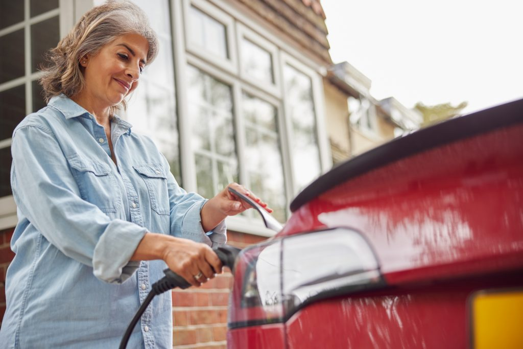 Electric Vehicle Home Charge Scheme - woman charging her car