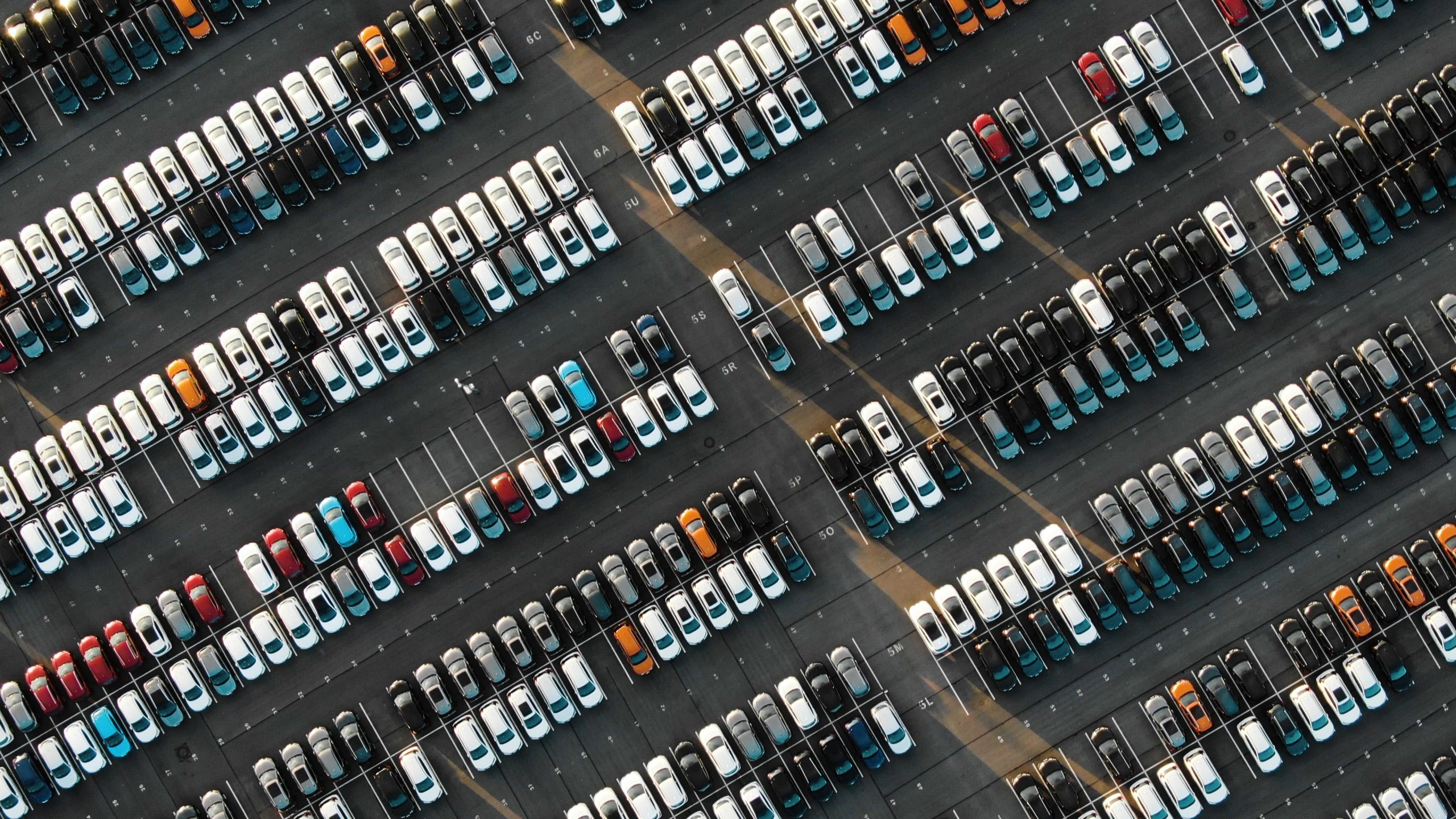 rows of in-stock cars at dealership