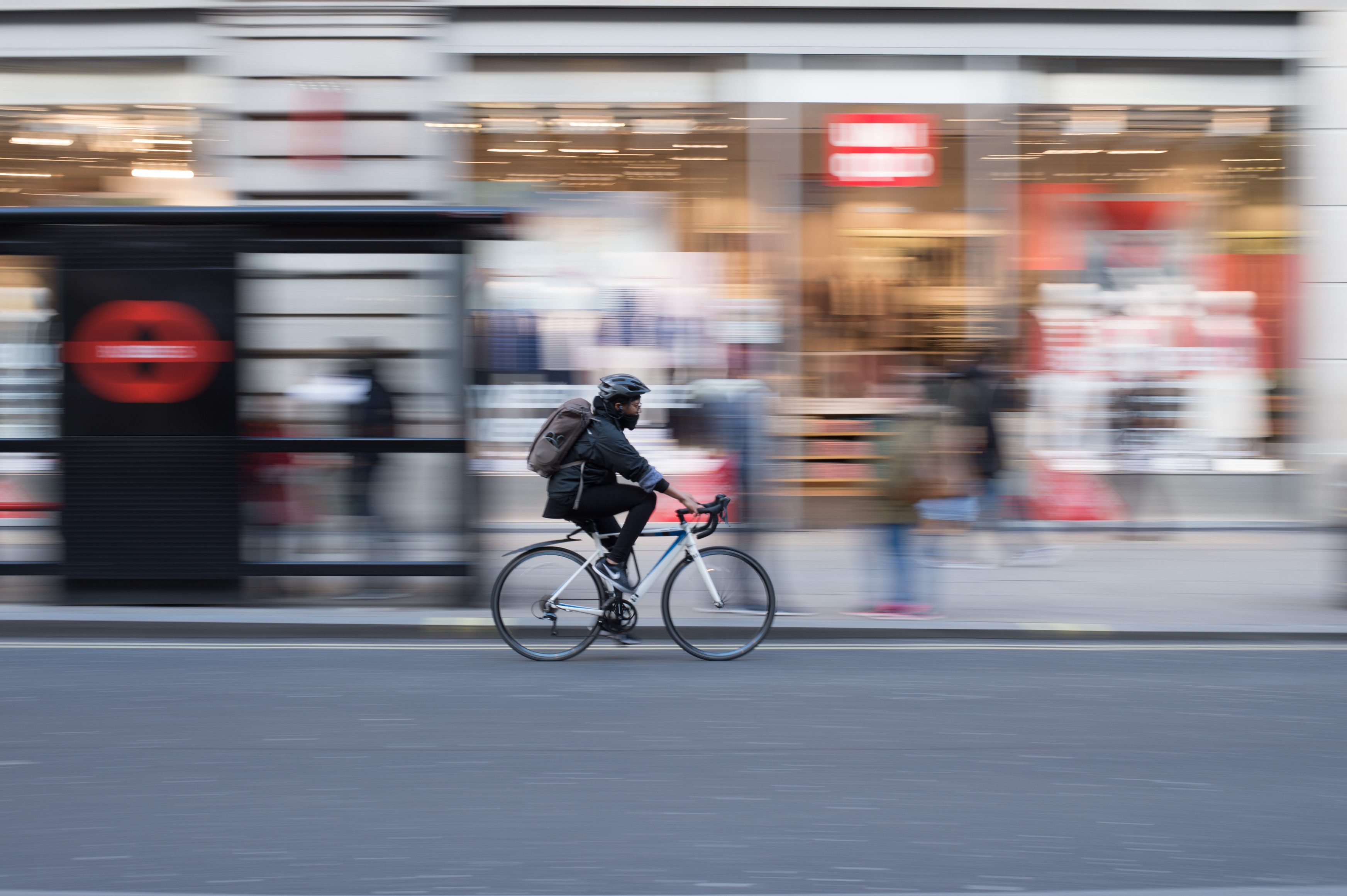 cycling to work in busy street