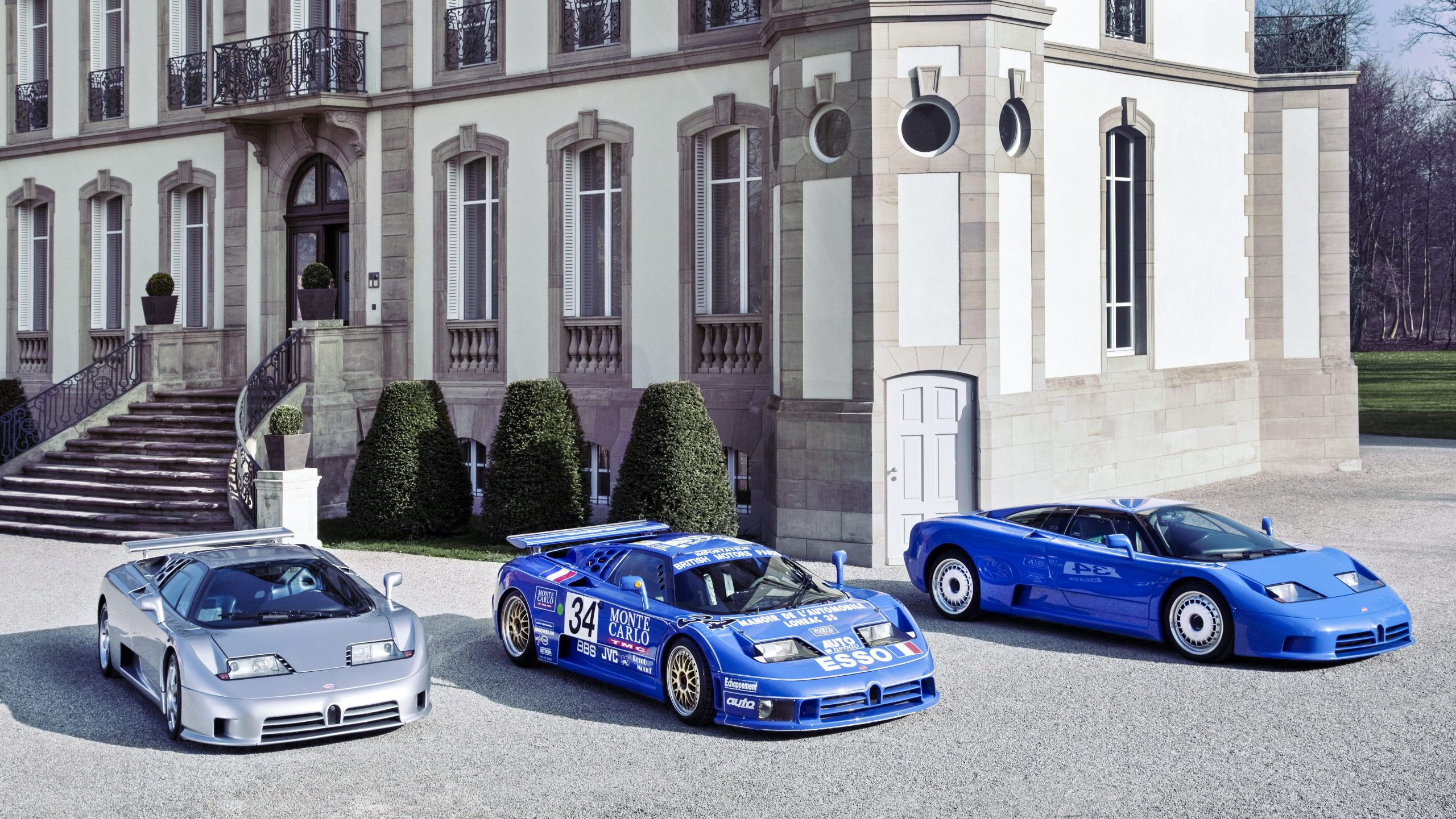 Three Bugatti EB110's parked up alongside each other