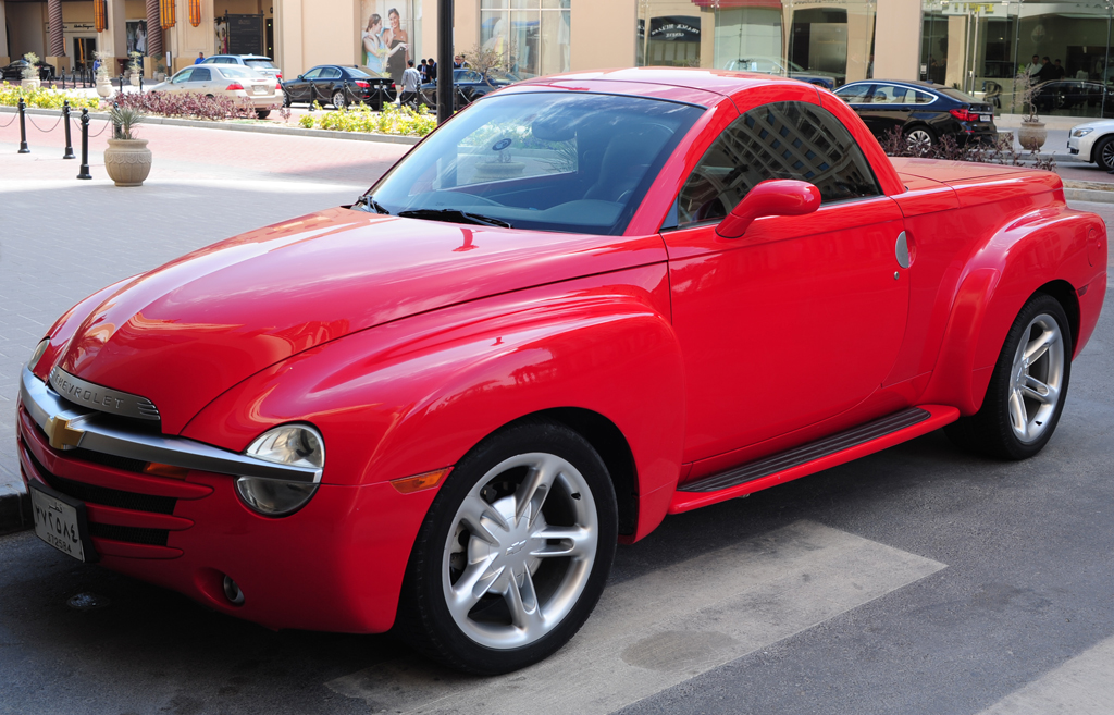 Bright red Chevrolet SSR convertible pick up truck