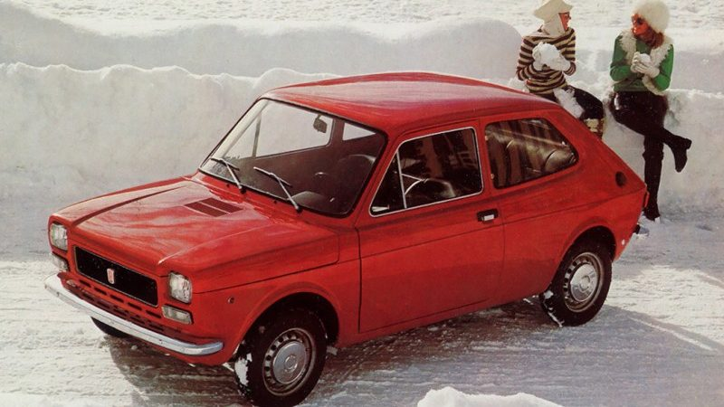 Red Fiat 127 in the snow