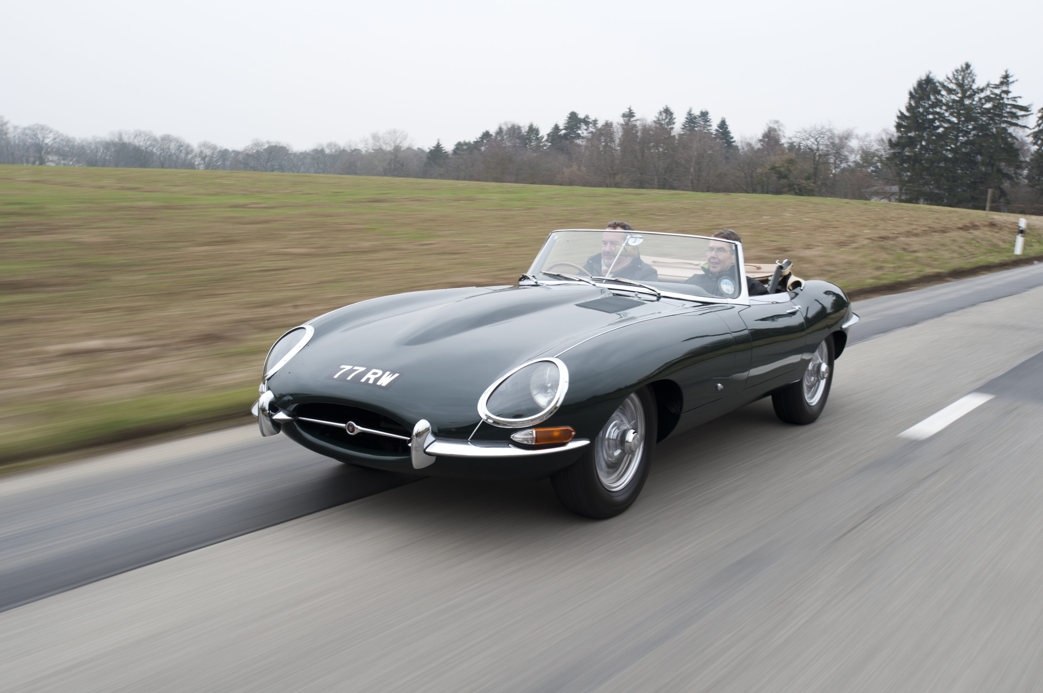 Jaguar E-Type driving at speed
