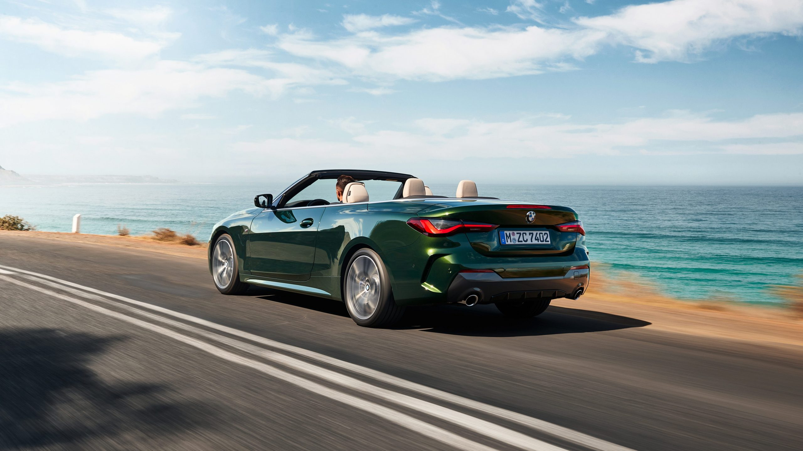 bmw 4 series convertible driving by the ocean