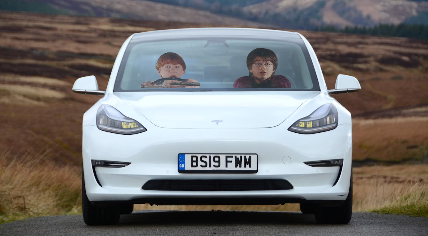harry potter and ron weasley in a tesla model 3