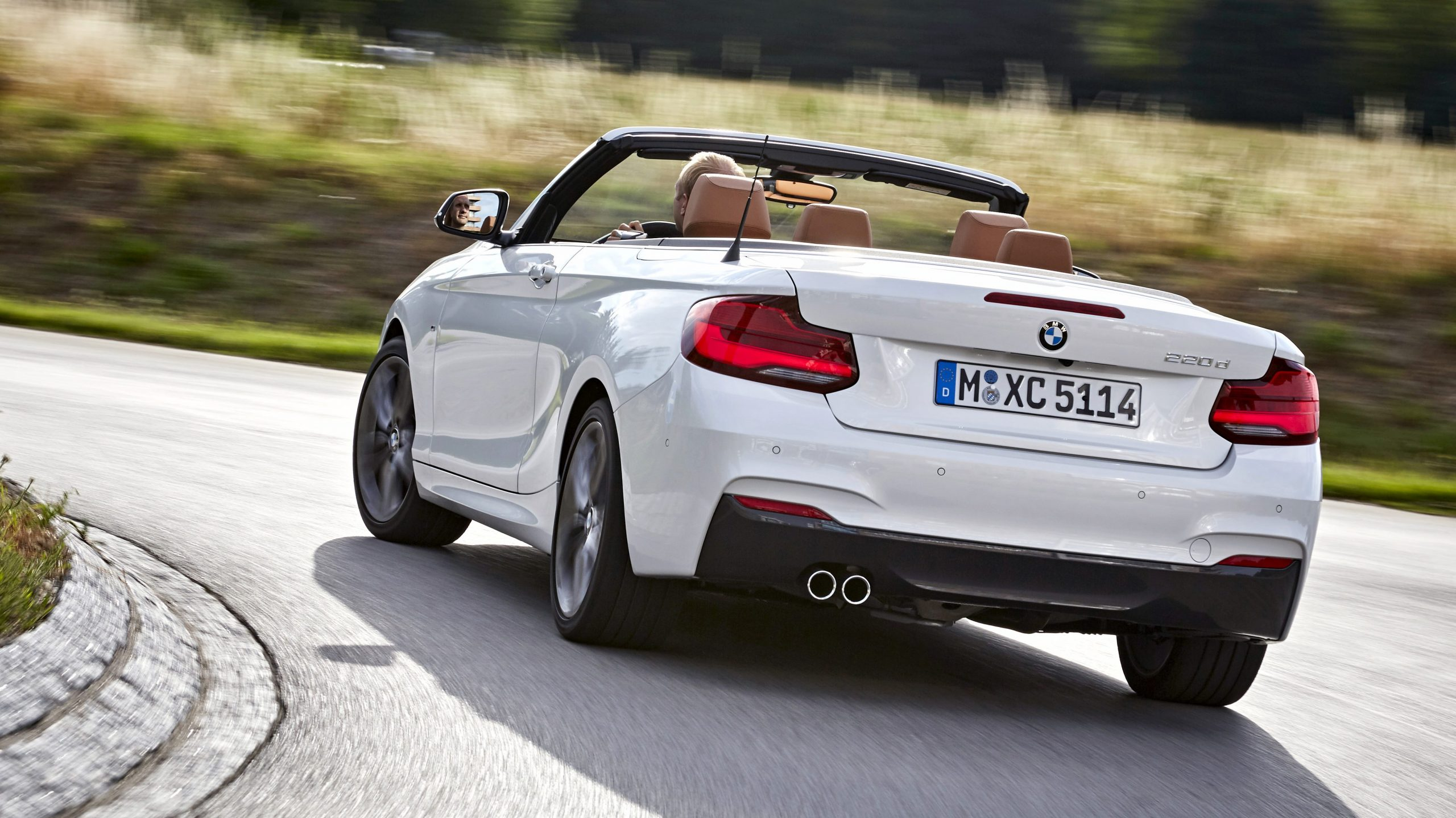 BMW 4 series convertible taking a corner