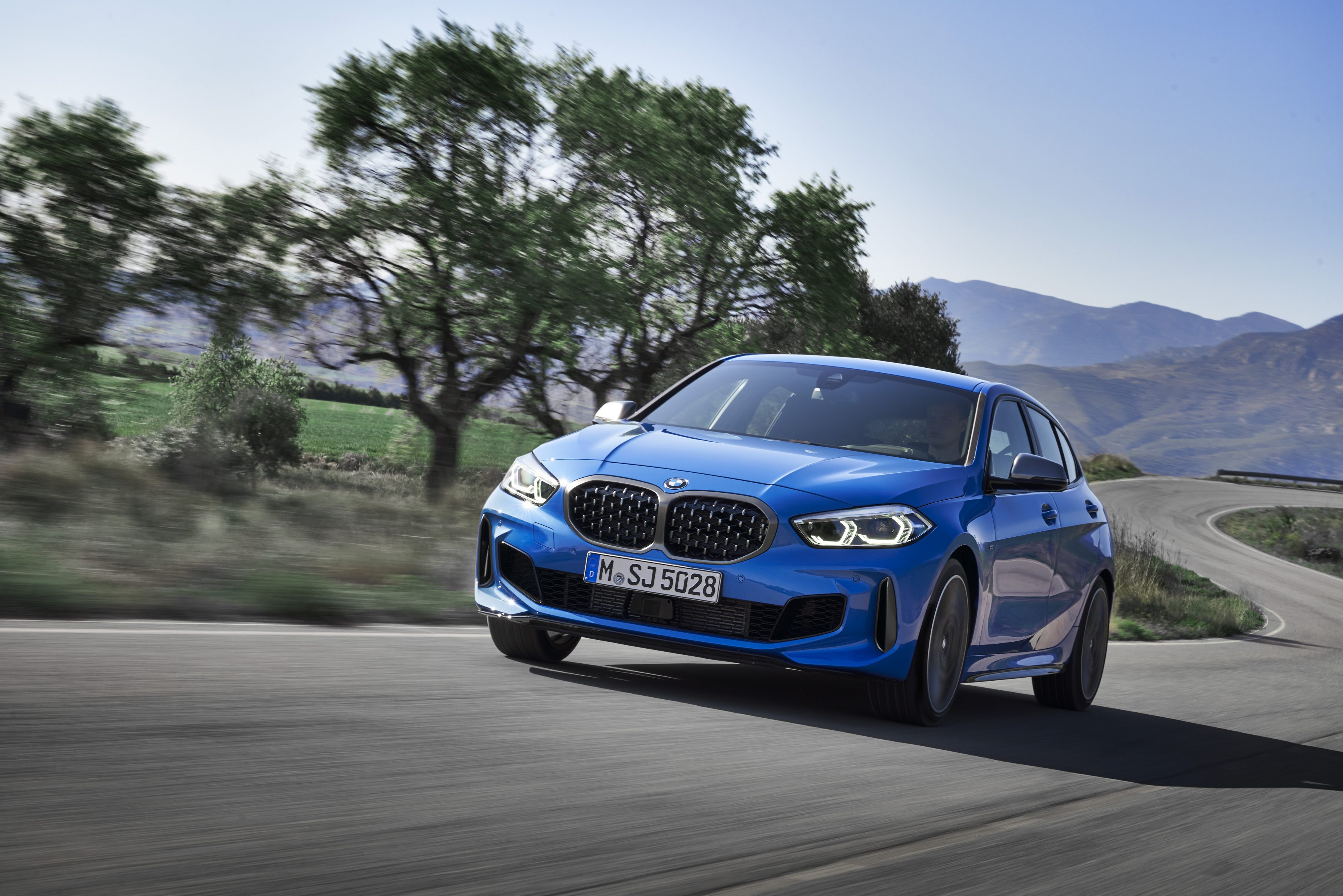 BMW 1 Series on a winding country road