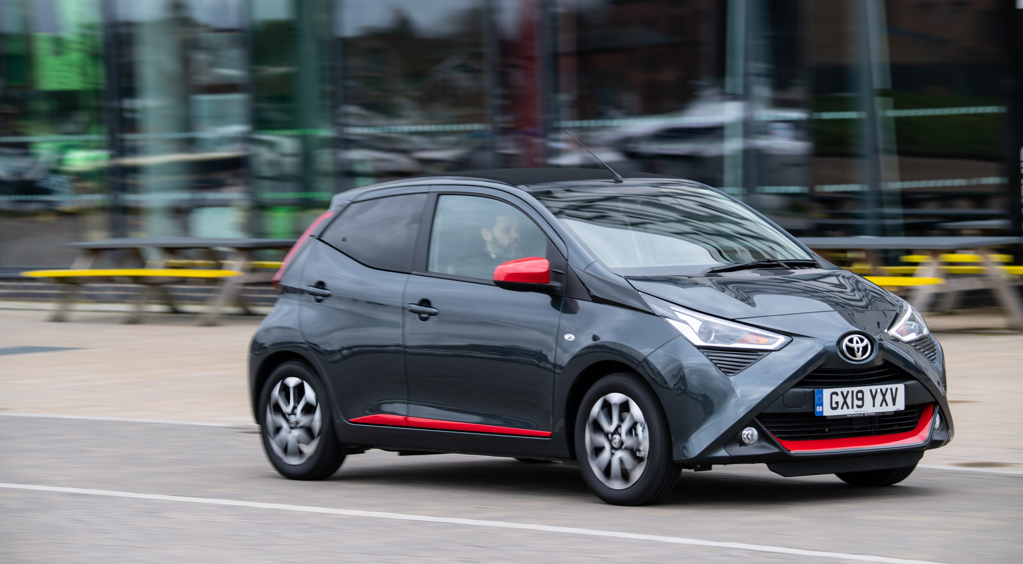 Toyota Aygo driving round a UK street