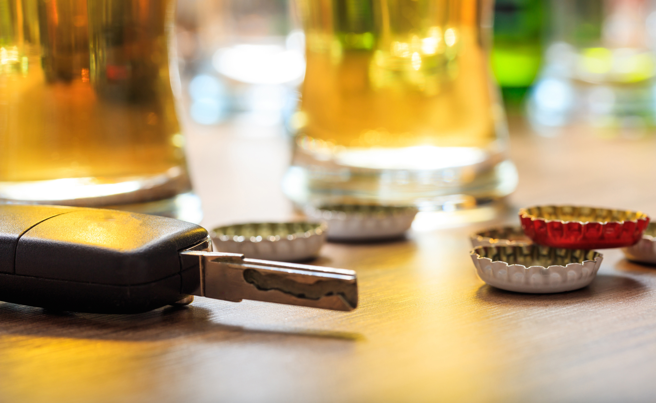 Drinking and driving concept showed with car keys next to beer