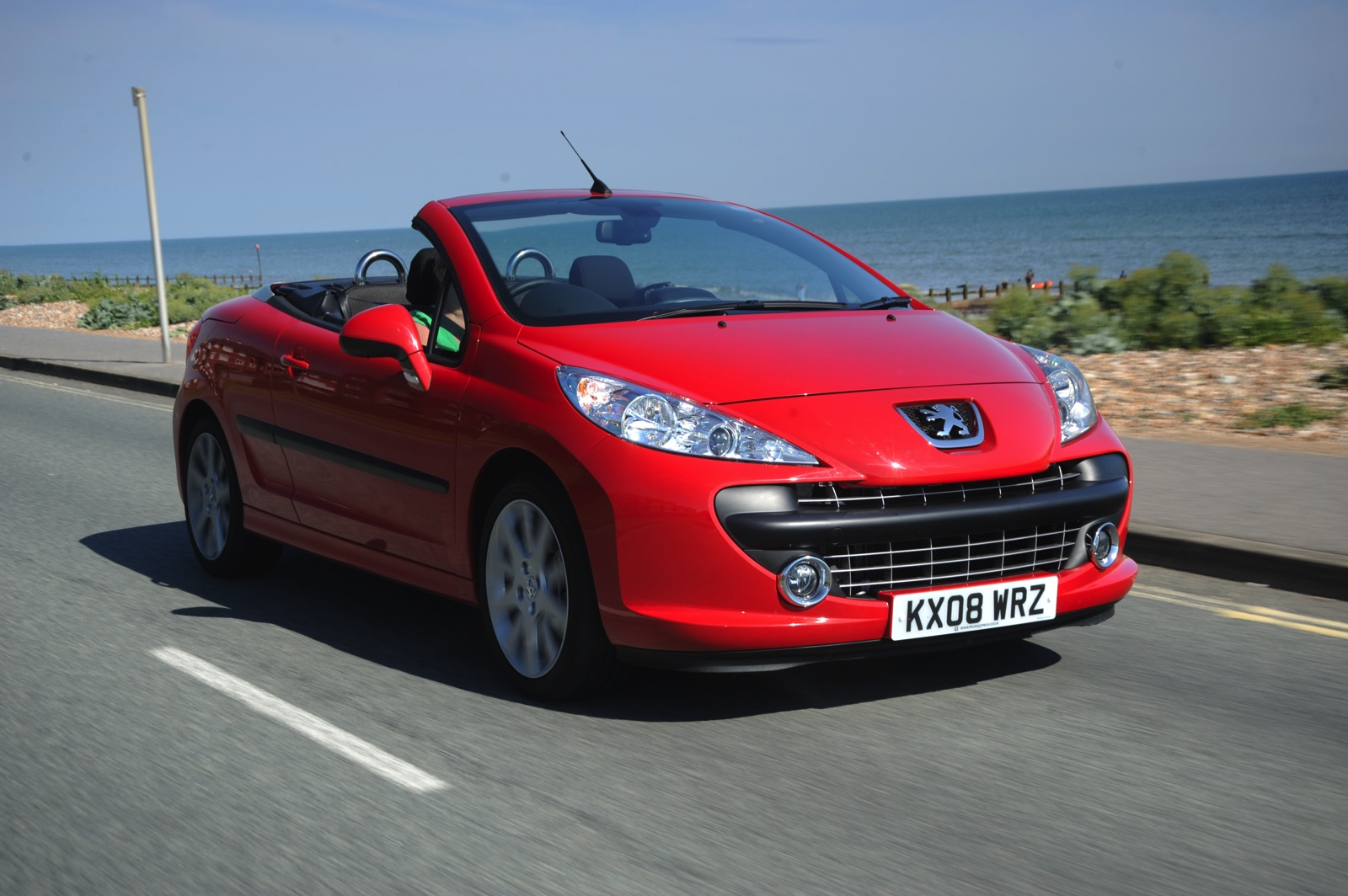 Peugeot 207 on a seaside road