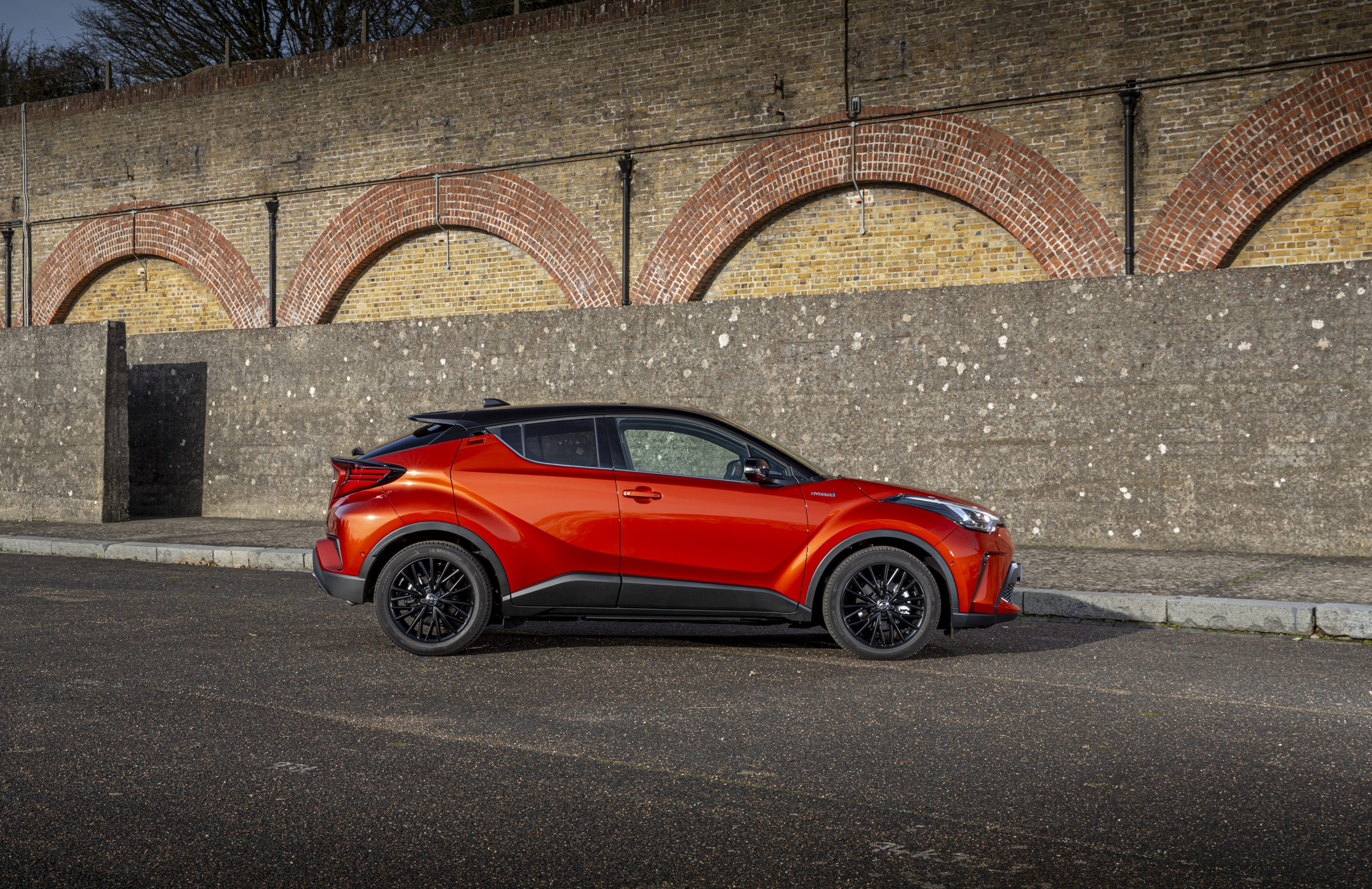Toyota-C-HR in orange pictured from the side