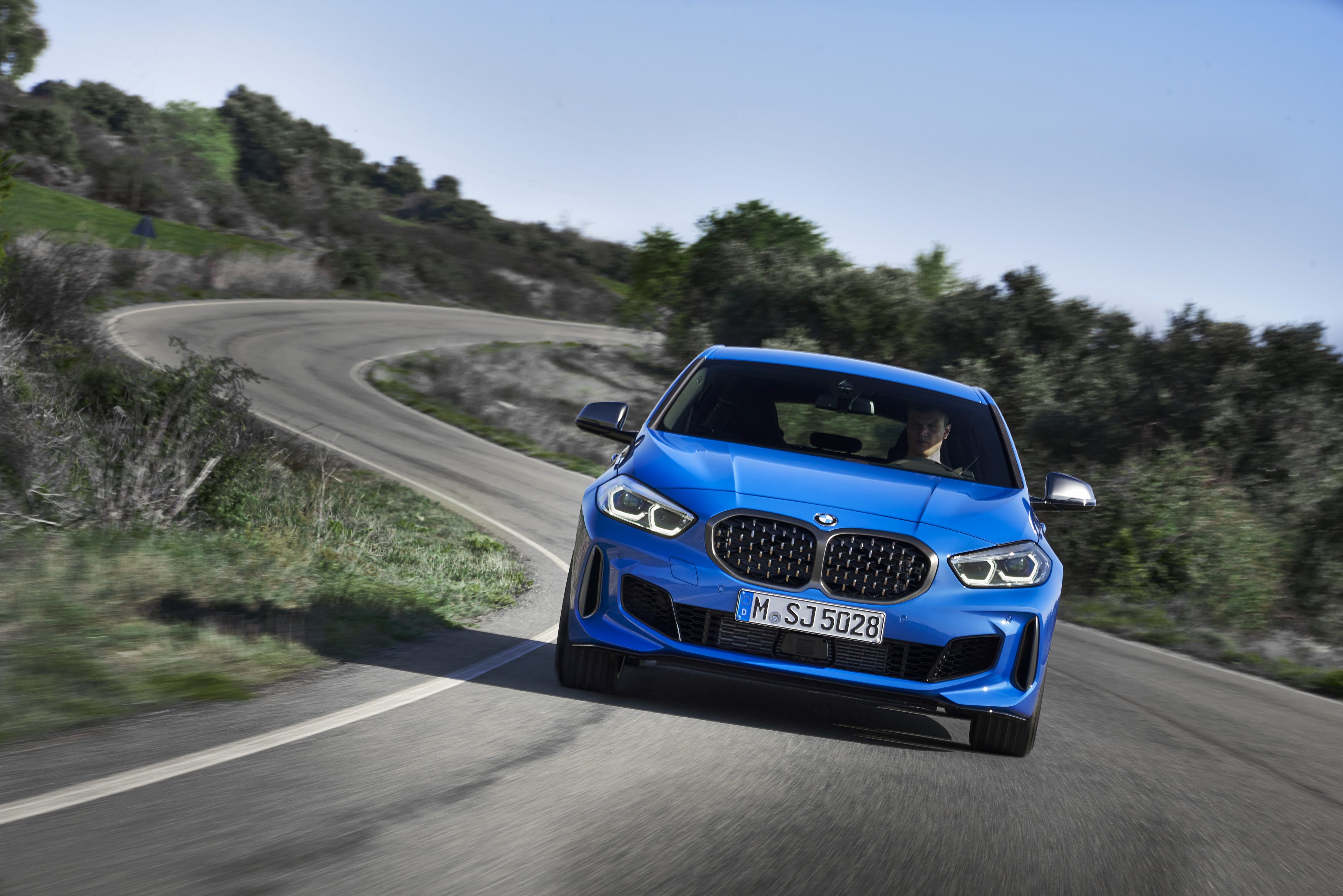 The all new BMW 1 Series driving on a country road