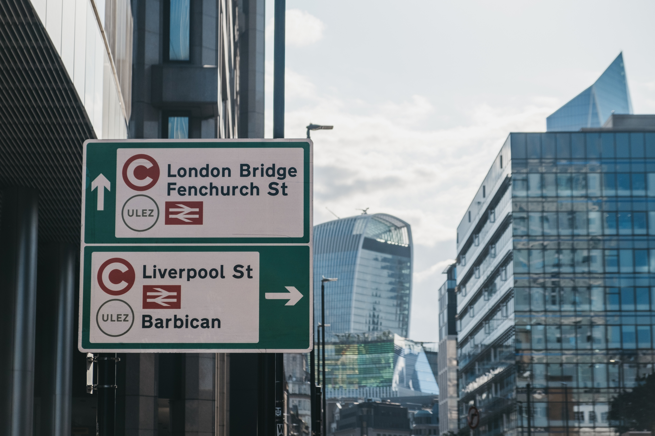 Signs indicating the direction of Ultra Low Emission Zone (ULEZ) on a street in London, UK.
