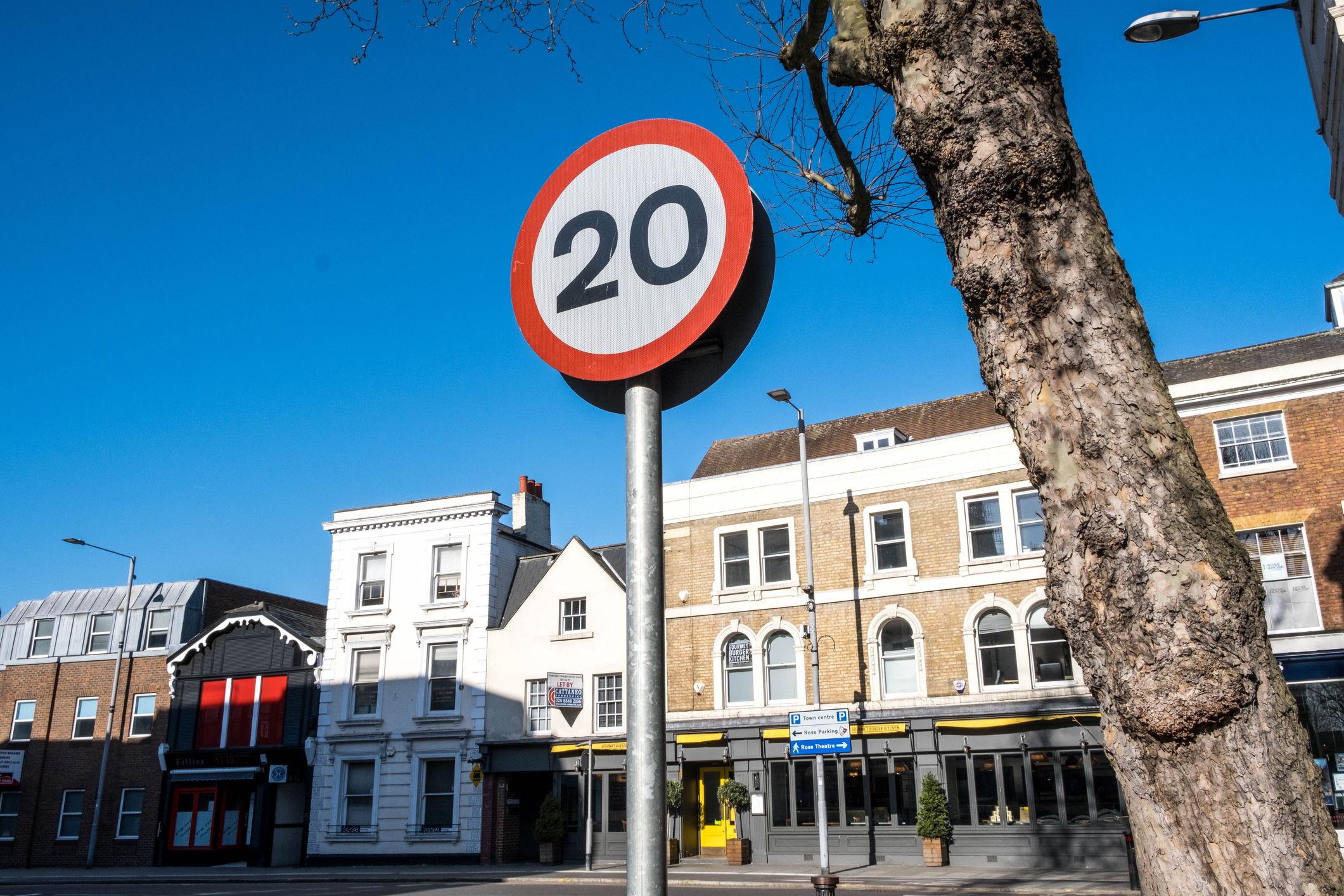 20mph Road Speed Limit Traffic Sign Against A Blue Sky With No People