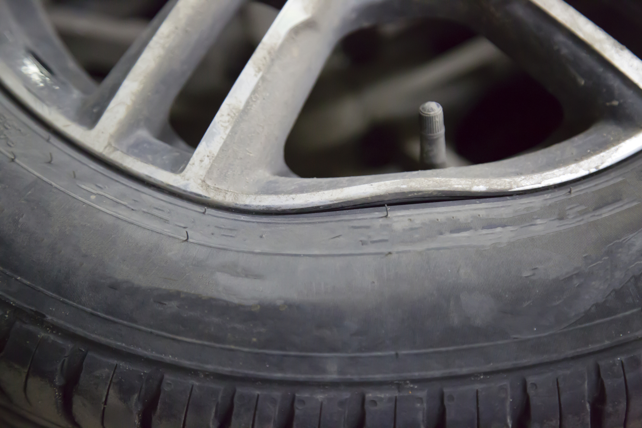 Damaged disc and tire of the car