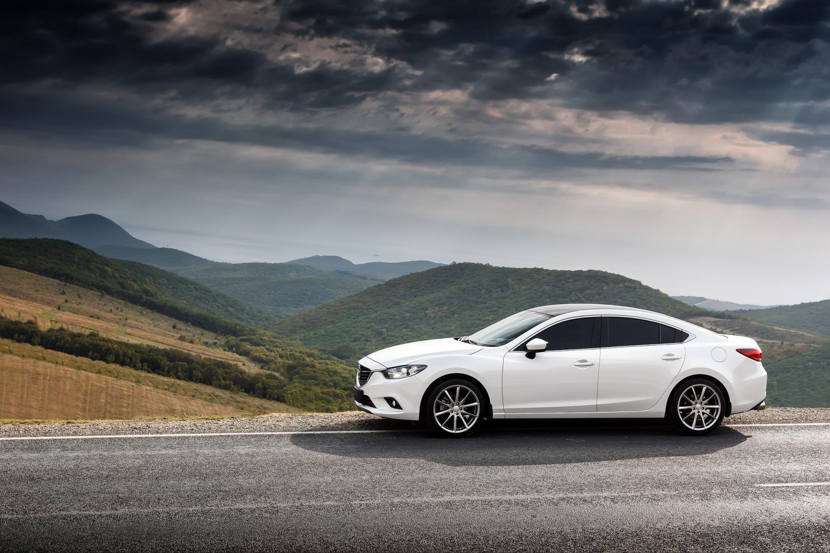 White Car Mazda 6 parket at countryside asphalt road