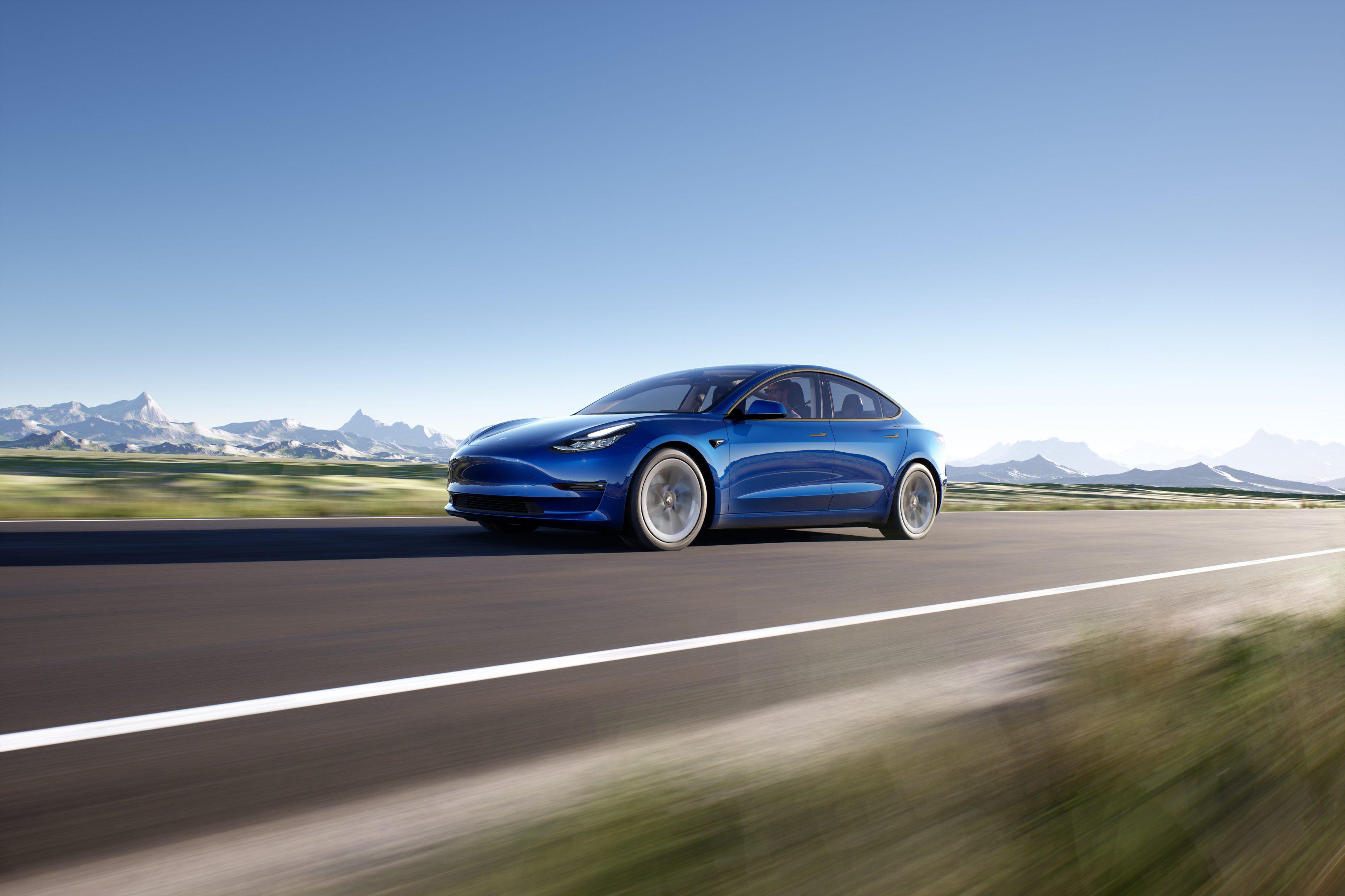Tesla Model 3 2021 exterior driving shot