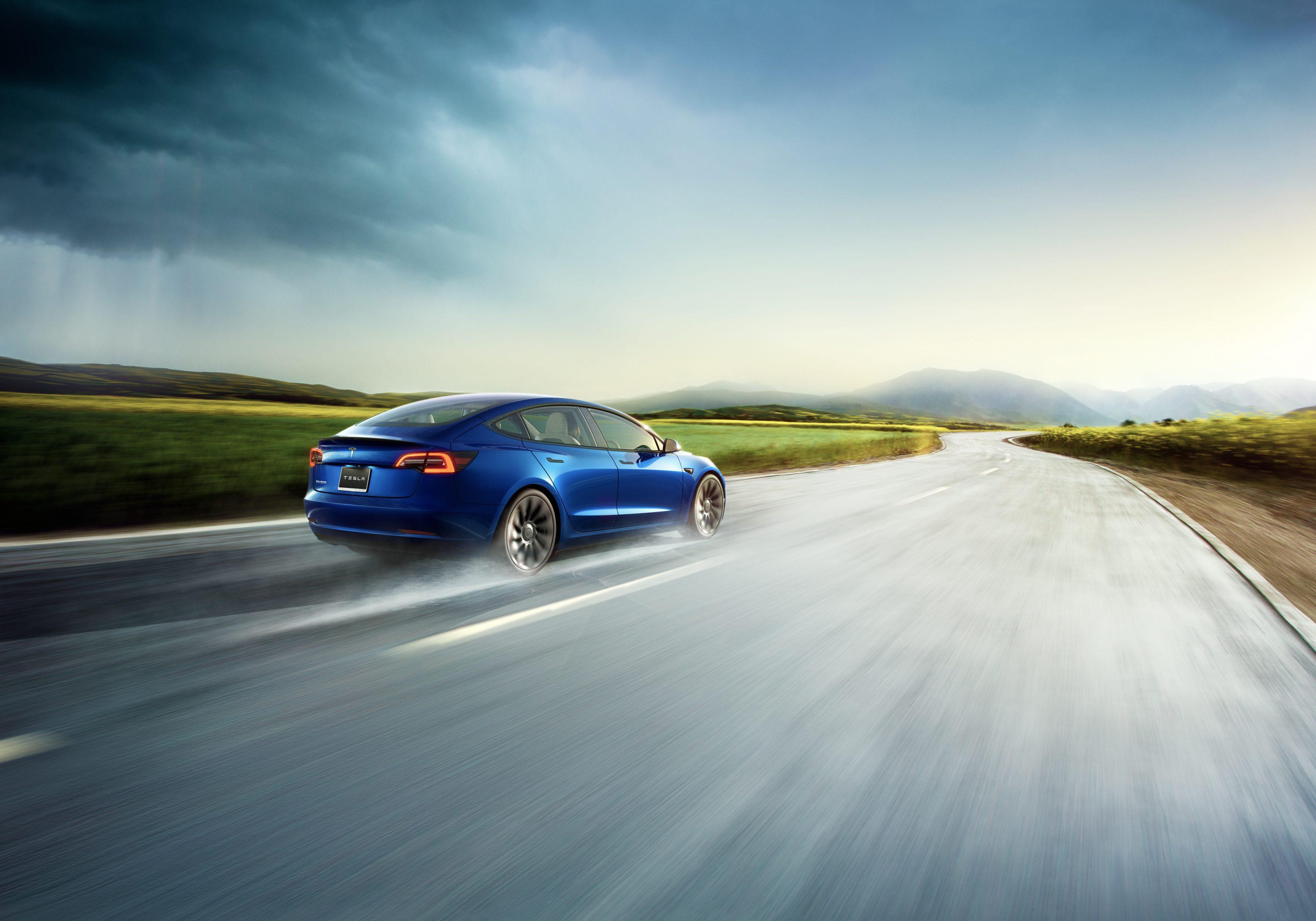Tesla Model 3 2021 rear shot driving